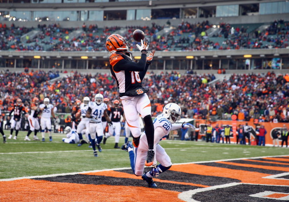 A.J. Green#18  of the Cincinnati Bengals catches a touchdown pass during the NFL game against the Indianapolis Colts  at Paul Brown Stadium on December 8, 2013 in Cincinnati, Ohio.  (Photo by Andy Lyons/Getty Images)
