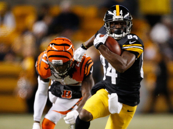 Antonio Brown #84 of the Pittsburgh Steelers heads up field after getting around the tackle of Dre Kirkpatrick #27 of the Cincinnati Bengals after a fist quarter reception at Heinz Field on December 15, 2013 in Pittsburgh, Pennsylvania.  (Photo by Gregory Shamus/Getty Images)