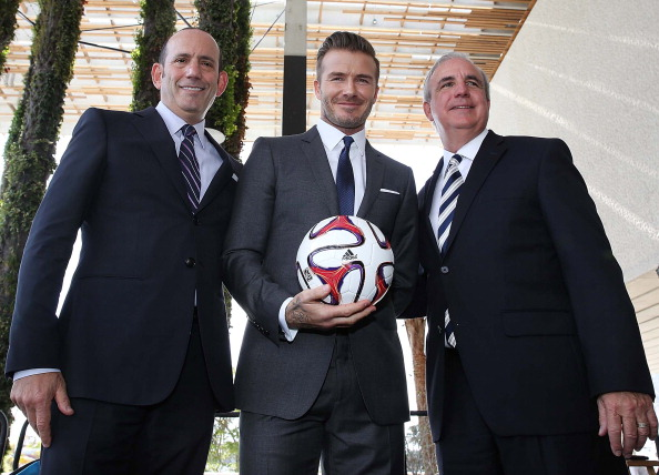 Commissioner Don Garber, David Beckham and Mayor Carlos Gimenez attends a press conference to announce their plans to launch a new Major League Soccer franchise at PAMM Art Museum on February 5, 2014 in Miami, Florida. (Photo by Aaron Davidson/Getty Images)