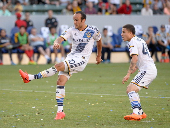 Landon Donovan #10 of Los Angeles Galaxy watches his goal with Raul Mendiola #40 during the second half against the Philadelphia Union at StubHub Center on May 25, 2014 in Los Angeles, California.  (credit: Harry How/Getty Images)