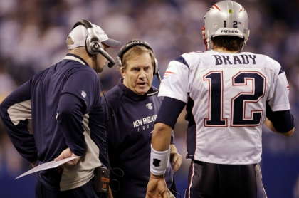 INDIANAPOLIS - NOVEMBER 15: Quarterback Tom Brady #12 of the New England Patriots speaks to head coach Bill Belichick in the fourth quarter of the game against the Indianapolis Colts at Lucas Oil Stadium on November 15, 2009 in Indianapolis, Indiana. The Colts won the game 35-34. (Photo by Andy Lyons/Getty Images)