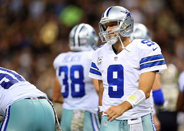 NEW ORLEANS, LA - NOVEMBER 10:  Quarterback Tony Romo #9 of the Dallas Cowboy reacts against the New Orleans Saints during a game at the Mercedes-Benz Superdome on November 10, 2013 in New Orleans, Louisiana.