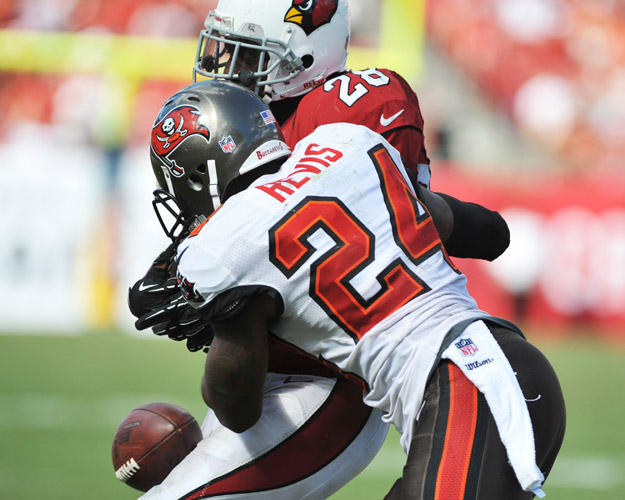 TAMPA, FL - SEPTEMBER 29:  Cornerback Darrelle Revis #24 of the Tampa Bay Buccaneers knocks down a pass to running back Rashard Mendenhall #28 of the Arizona Cardinals  September 29, 2013 at Raymond James Stadium in Tampa, Florida.