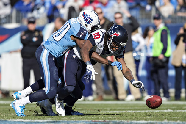 NASHVILLE, TN - DECEMBER 29:  Alterraun Verner #20 of the Tennessee Titans knocks the pass out of the hands of DeAndre Hopkins #10 of the Houston Texans at LP Field on December 29, 2013 in Nashville, Tennessee.  The Titans defeated the Texans 16-10.