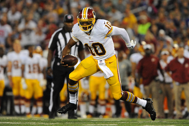 BALTIMORE, MD - AUGUST 23:  Quarterback Robert Griffin III #10 of the Washington Redskins scrambles during a preseason game against the Baltimore Ravens at M&T Bank Stadium on August 23, 2014 in Baltimore, Maryland.