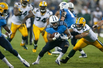 NASHVILLE, TN - AUGUST 09: Bishop Sankey #20 of the Tennessee Titans runs with the ball in the second half of an NFL preseason game against the Green Bay Packers at LP Field on August 9, 2014 in Nashville, Tennessee. The Titans won 20-16. (Photo by Joe Robbins/Getty Images)