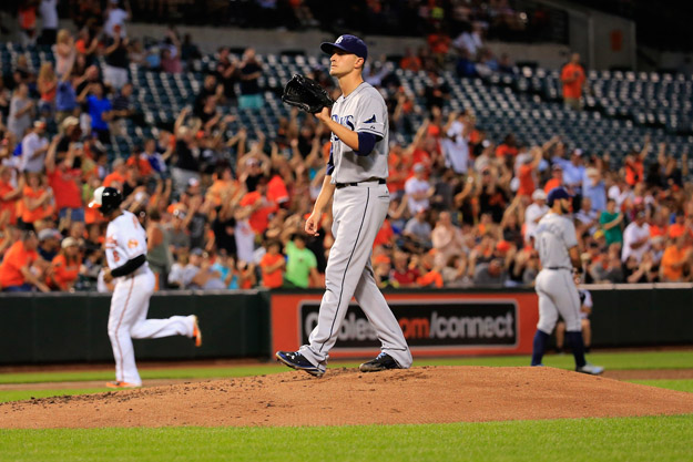 BALTIMORE, MD - AUGUST 25: Starting pitcher Jake Odorizzi #23 of the Tampa Bay Rays looks on after giving up a two RBI home run to the Baltimore Orioles in the third inning at Oriole Park at Camden Yards on August 25, 2014 in Baltimore, Maryland.