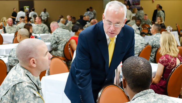 Bob Williams, Global Training Solutions vice president for Raytheon Intelligence, Information and Services, speaks to soldiers among the first graduates of the Shifting Gears program at Fort Hood, Texas, Oct. 28. Photo by Pat McKenna/Raytheon